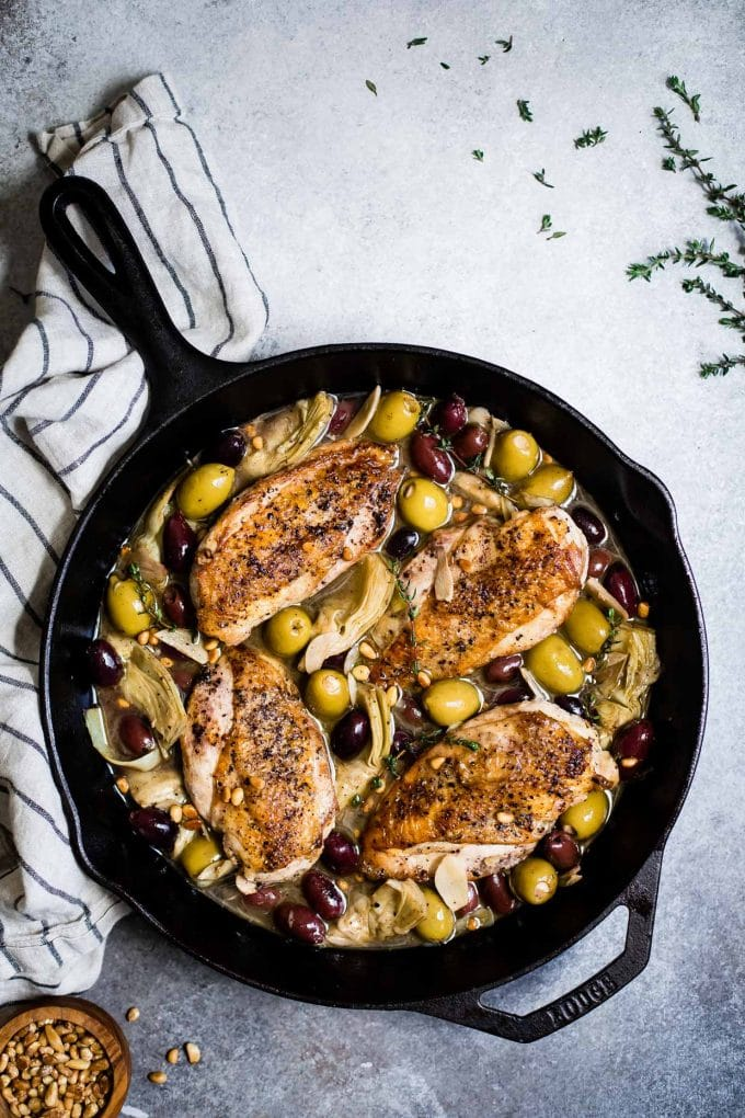 Garlic White Wine Skillet Chicken with Olives & Artichokes from snixykitchen.com on foodiecrush.com
