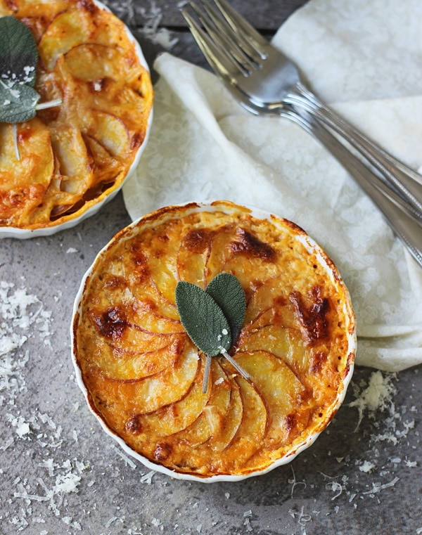 Individual Pumpkin and Potato Gratins with Gruyere and Sage from cookingforkeeps.com on foodiecrush.com