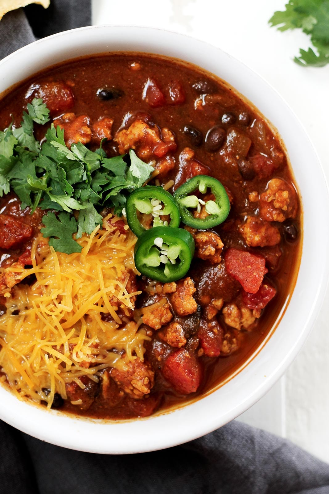 Slow Cooker Black Bean Pumpkin Turkey Chili from ambitiouskitchen.com on nourishedplanner.com