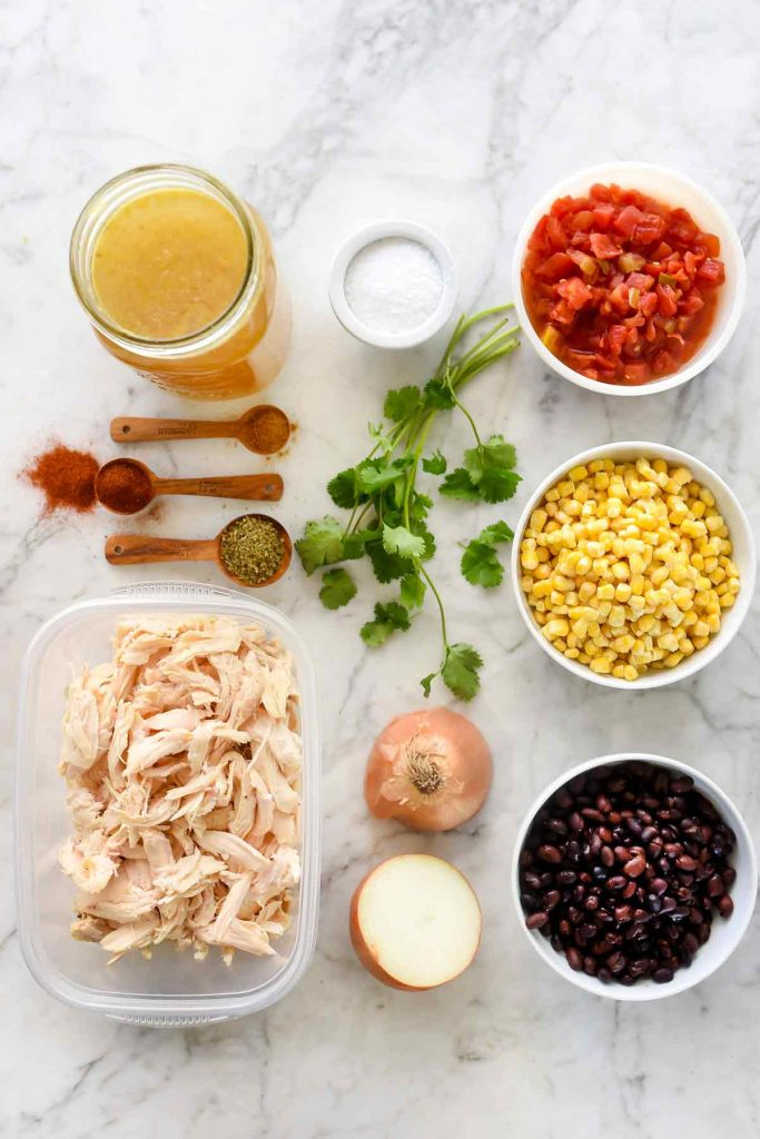 chicken tortilla soup ingredients on marble countertop