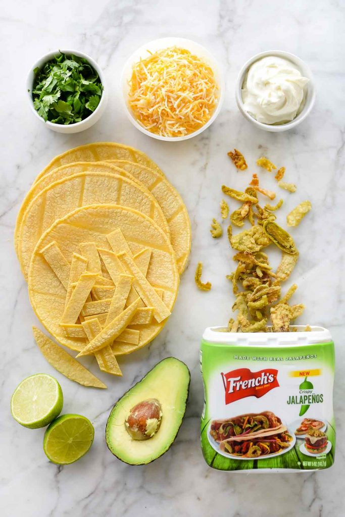easy chicken tortilla soup toppings on marble countertop