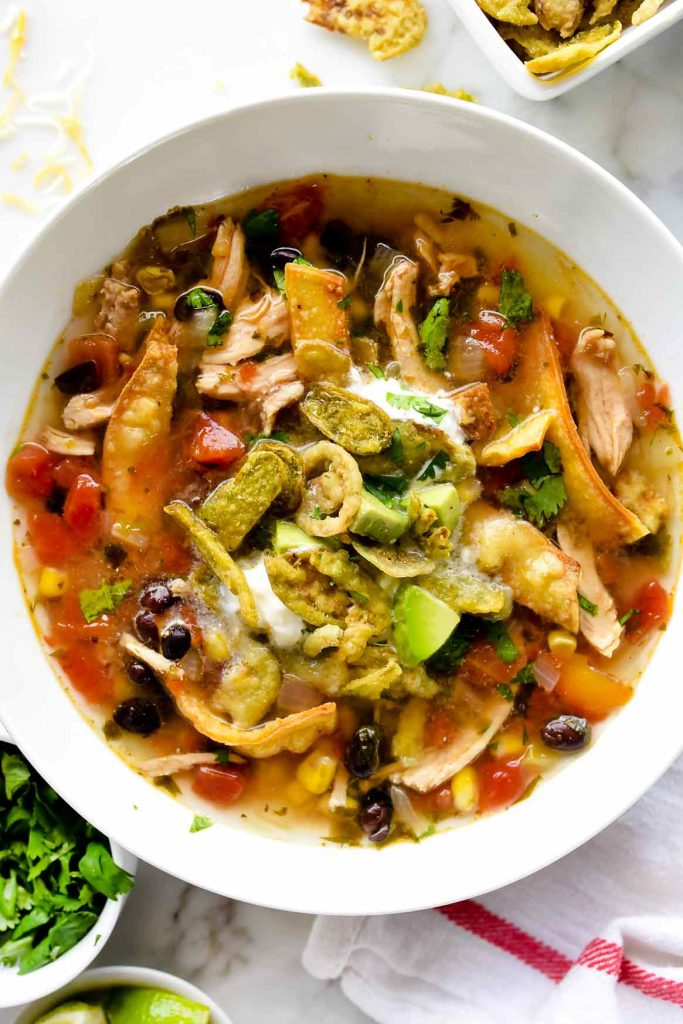 bowl of the best chicken tortilla soup with toppings