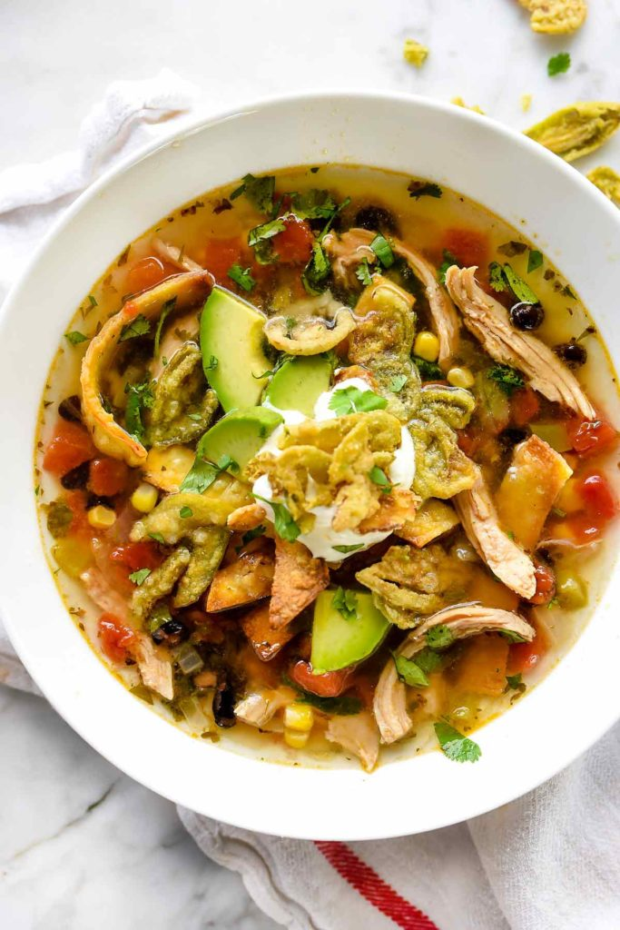 bowl of chicken tortilla soup with toppings