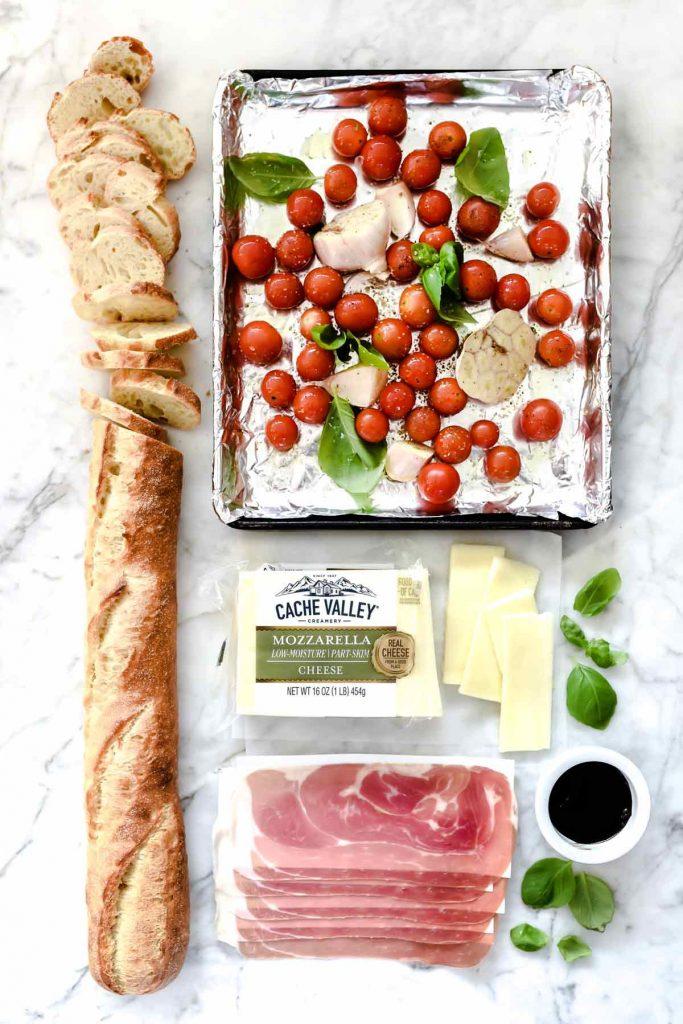 Melted Mozzarella Caprese Crostini Toasts   foodiecrush.com #appetizer #crostini #caprese #recipes