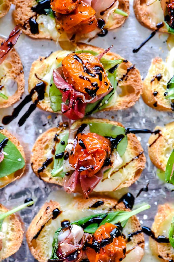Melted Mozzarella Caprese Crostini Toasts | foodiecrush.com #appetizer #crostini #caprese #recipes