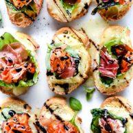Melted Mozzarella Caprese Crostini Toasts | foodiecrush.com #appetizer #crostini #caprese #recipes