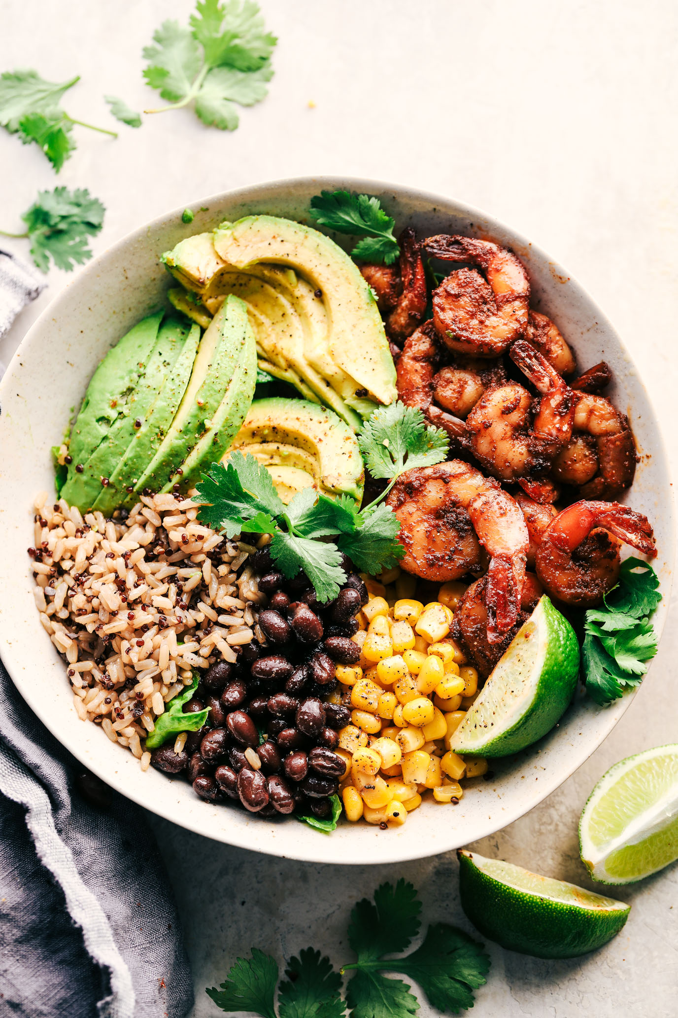 Blackened Shrimp Avocado Burrito Bowls from therecipecritic.com on foodiecrush.com