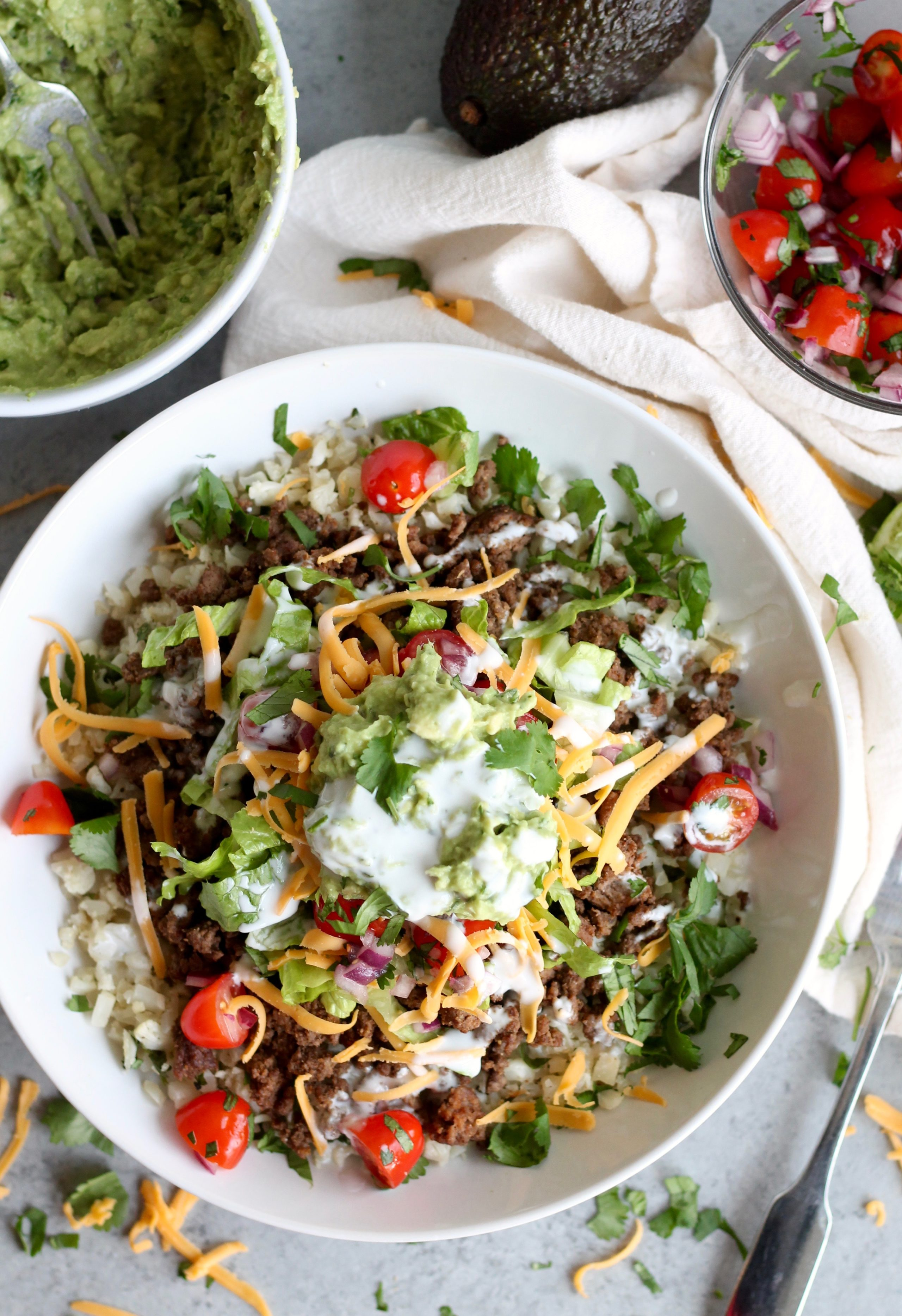 Beef Burrito Bowls with Cilantro Lime Cauliflower Rice from spicesinmydna.com on foodiecrush.com
