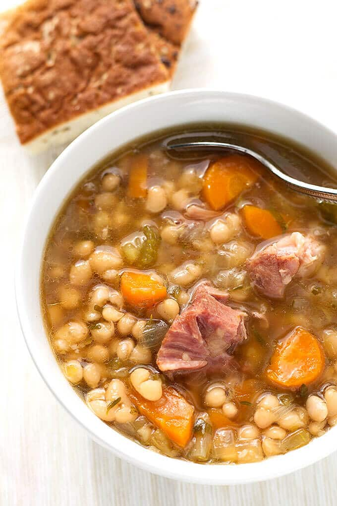 Instant Pot Ham Hock and Bean Soup from simplyhappyfoodie.com on foodiecrush.com