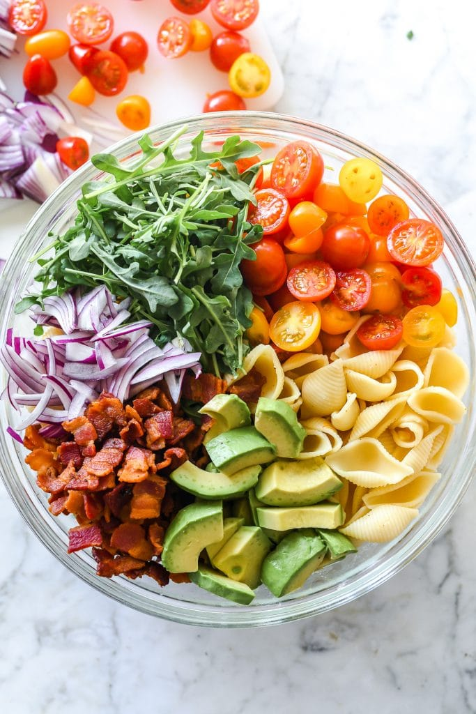 BLT pasta salad ingredients in glass bowl