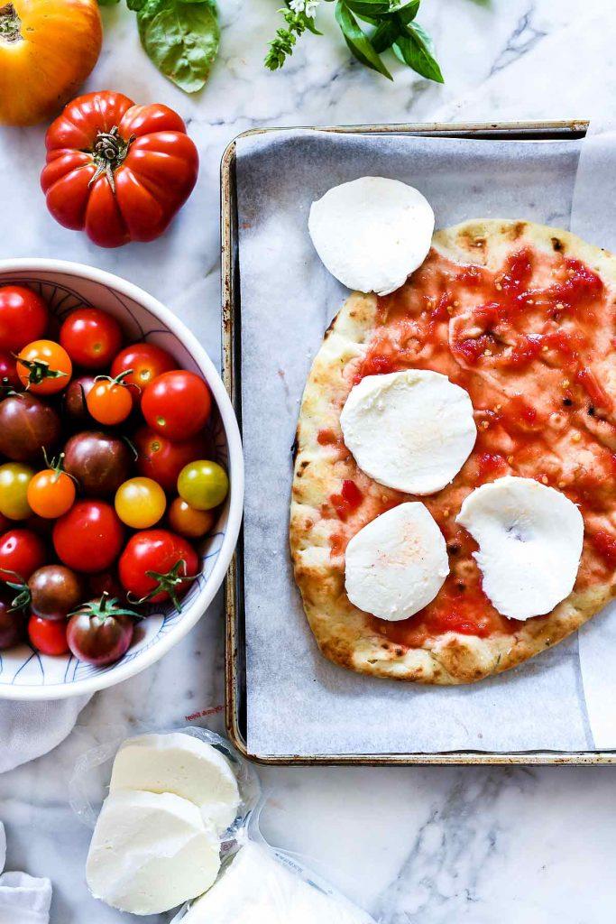 Mozzarella and Tomato Caprese Flatbread Ingredients | foodiecrush.com #flatbread #pizza #tomato #mozzarella #appetizer #recipes #dinner