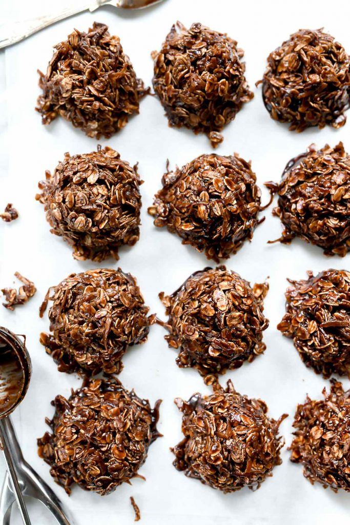no bake chocolate oatmeal cookies with coconut on parchment paper