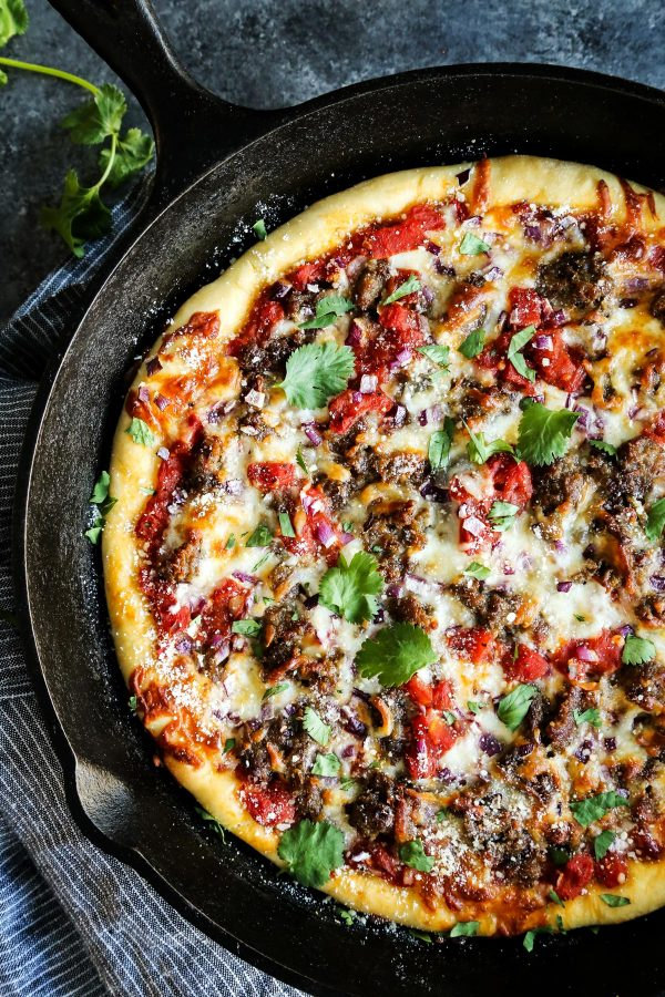 Skillet Pizza with Sausage and Chili Garlic Tomato Sauce from a Farmgirl's Dabbles | foodiecrush.com