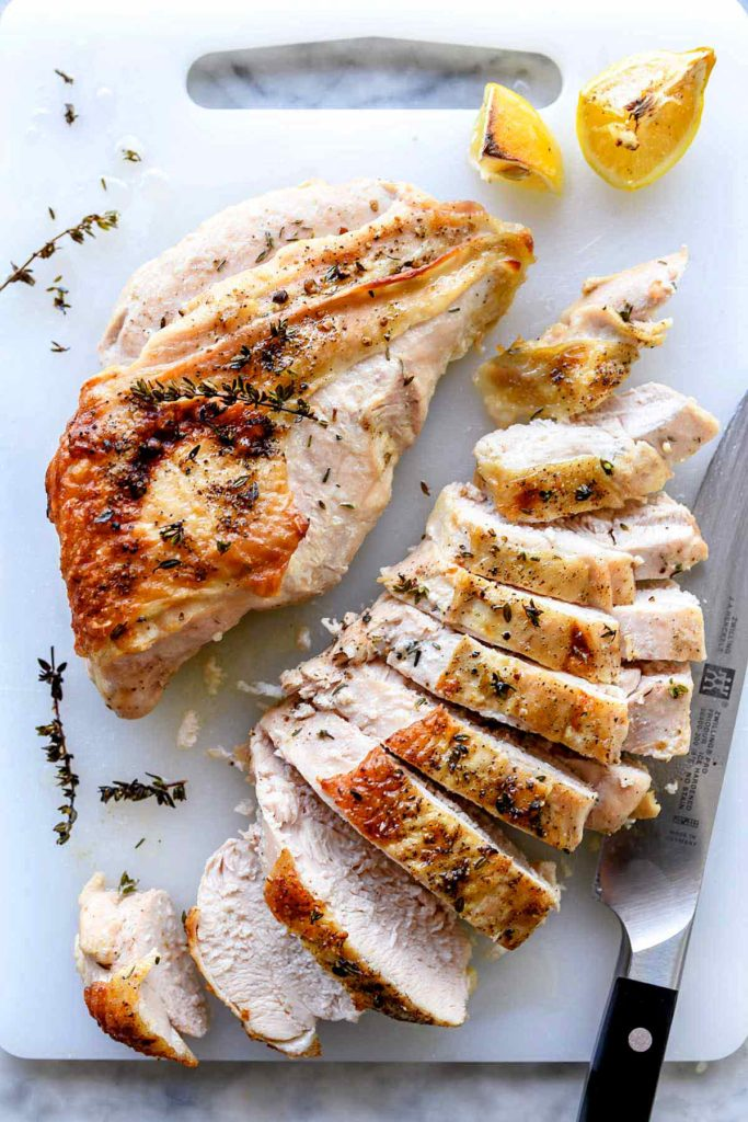 roast turkey breast on cutting board