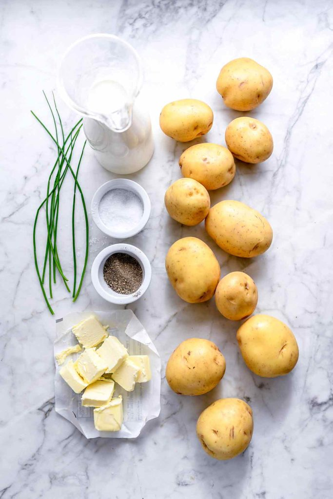 homemade mashed potatoes ingredients on marble countertop