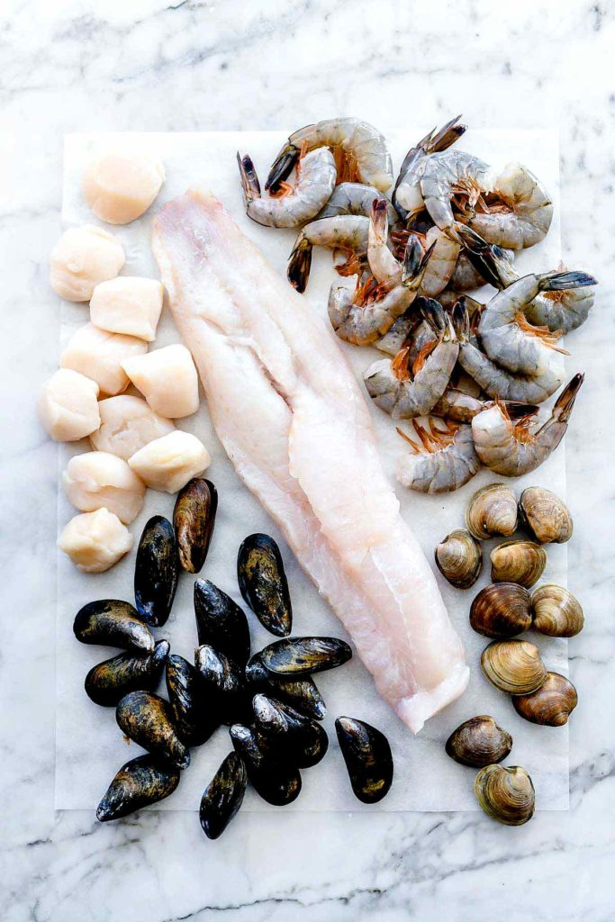 Ingredients for Cioppino Recipe Scallops Cod Mussels Shrimp Clams | foodiecrush.com #cioppino #seafood #easy #recipes