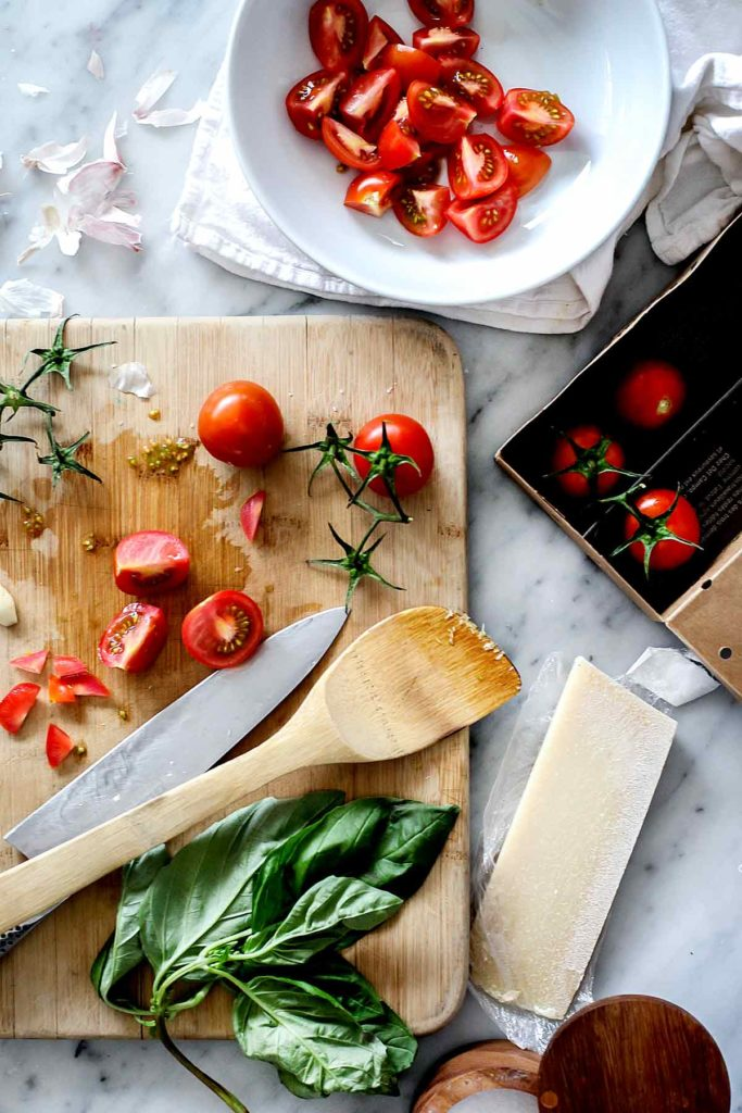 Fresh tomato sauce ingredients on a cutting board | foodiecrush.com
