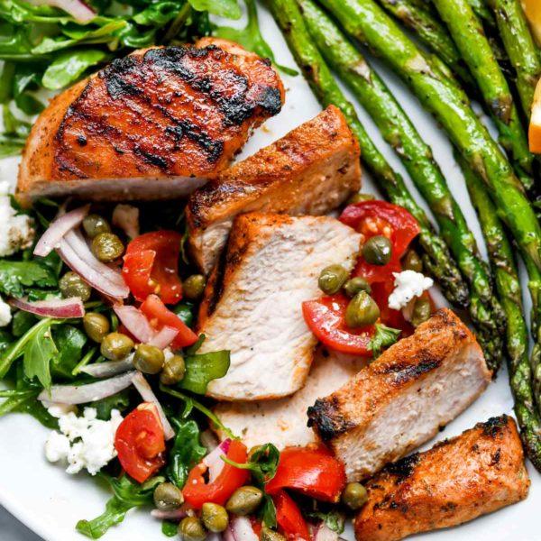 Mediterranean Grilled Pork Chops with Tomato Salad   foodiecrush.com #grilled #porkchops #recipes #dinner