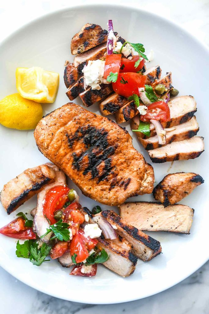 Mediterranean Grilled Pork Chops with Tomato Salad | foodiecrush.com #grilled #porkchops #recipes #dinner