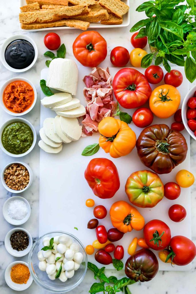 Heirloom Tomato Caprese Salad Ingredients | foodiecrush.com #caprese #salad #tomatoes #heirloom #basil #recipes