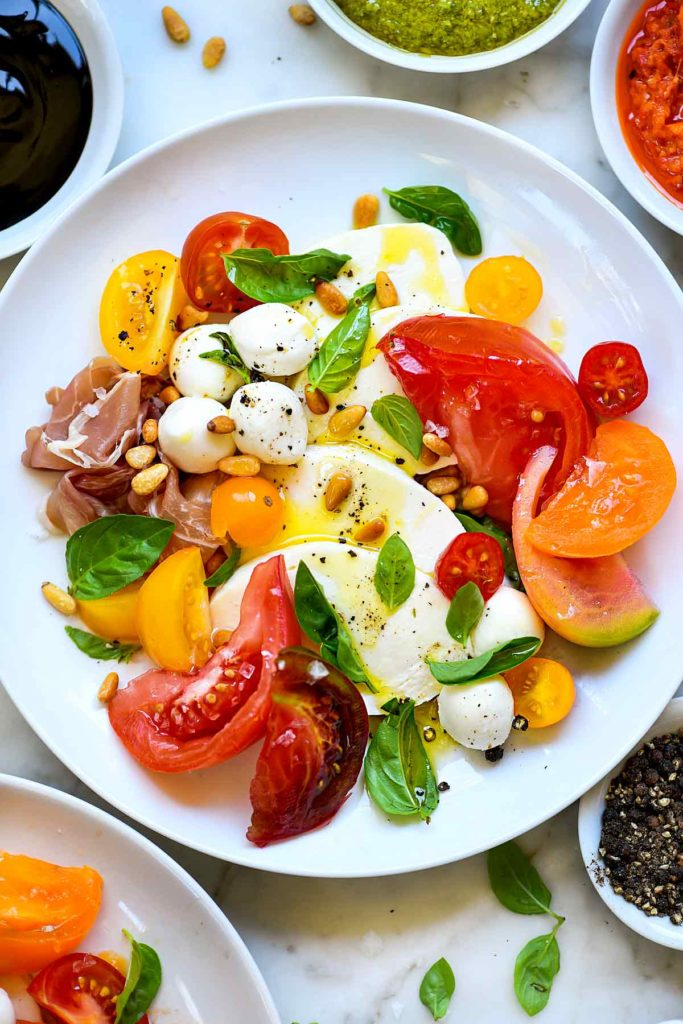 Caprese Salad with Heirloom Tomatoes | foodiecrush.com #caprese #salad #tomatoes #heirloom #basil #recipes