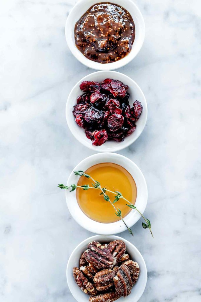 Toppings for Cranberry and Jam Baked Brie foodiecrush.com #appetizer #baked #brie #cranberries #pecan #fig jam