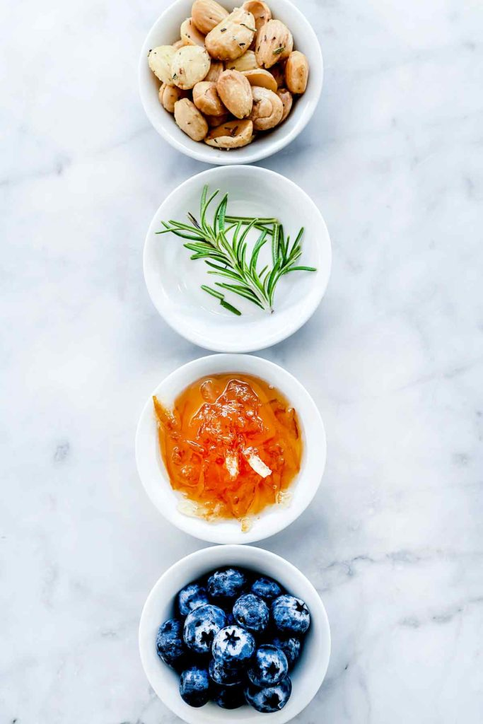 Toppings Baked Brie Blueberries Jam and Almonds foodiecrush.com #appetizer #recipes #baked #brie #holiday #jam #blueberries