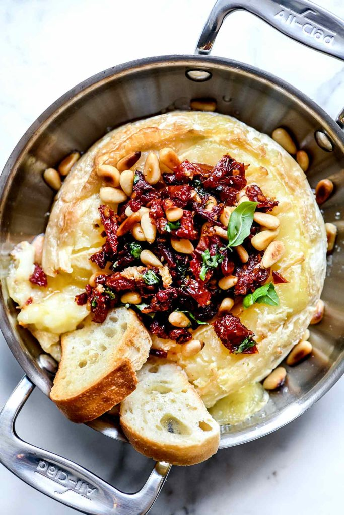 Sun Dried Tomato Baked Brie with Pinenuts | foodiecrush.com #appetizer #baked #brie #holiday #recipes #apptetizer