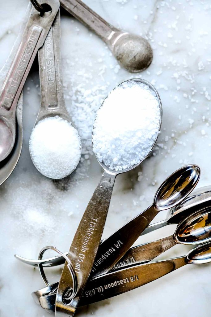Salt and sugar in measuring spoons foodiecrush.com