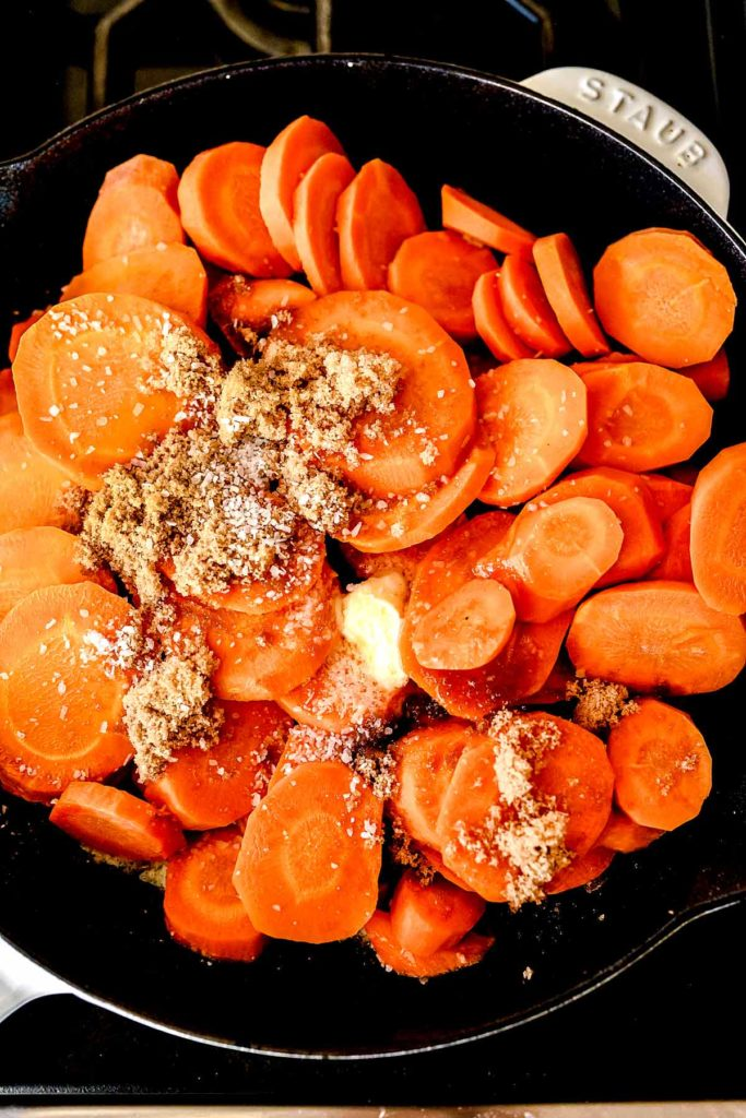 Glazed Carrots in a pan foodiecrush.com #carrots #sidedish #easy #brownsugar #recipe #stovetop