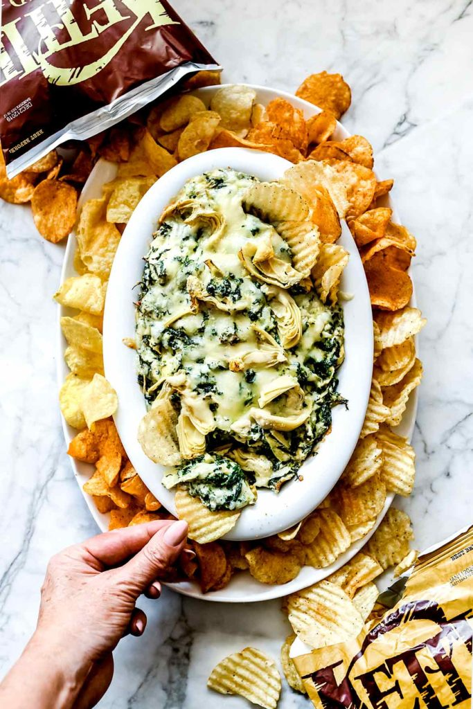 Easy Baked Spinach Artichoke Dip with Kettle Chips | foodiecrush.com