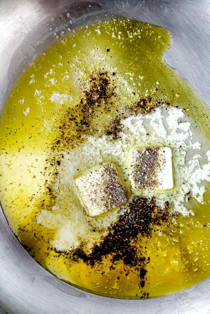 Butter olive oil and black pepper melting in pan | foodiecrush.com