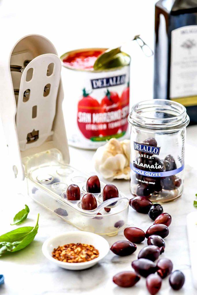 Pitting Olives | foodiecrush.com