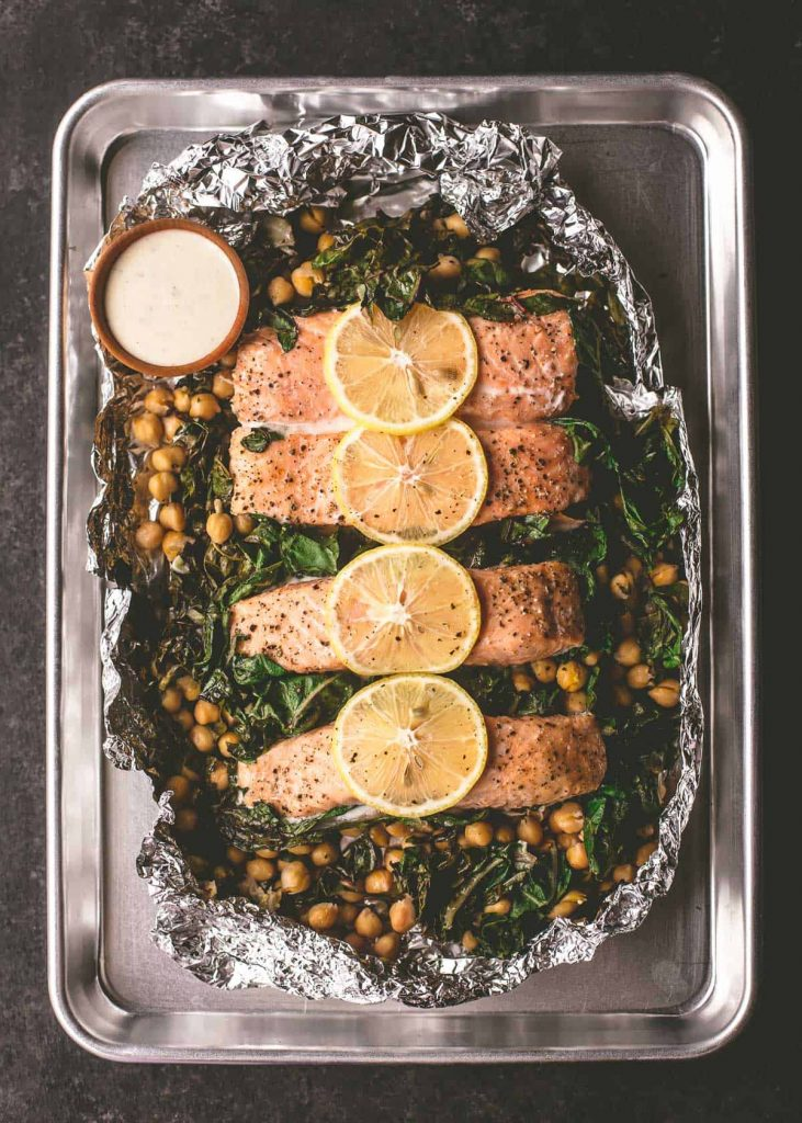 Foil Roasted Salmon with Chickpeas and Greens from Inquiring Chef on foodiecrush.com