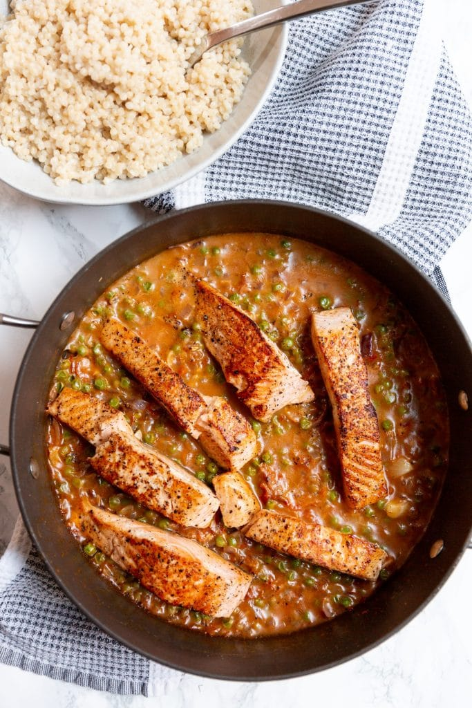 Salmon in Sun Dried Tomato Cream Sauce with Pearl Couscous from Inspiralized on foodiecrush.com