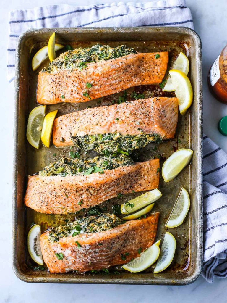 Easy Creamy Spinach Stuffed Salmon from The Defined Dish on foodiecrush.com