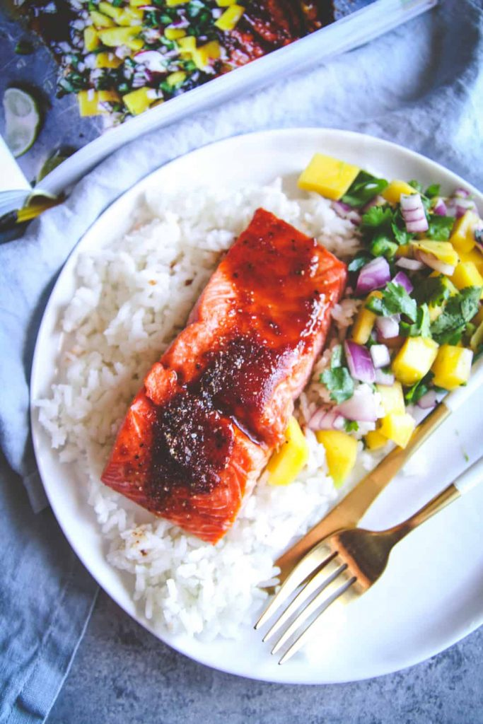 Baked BBQ Salmon with Mango Salsa from Sweet Phi on foodiecrush.com