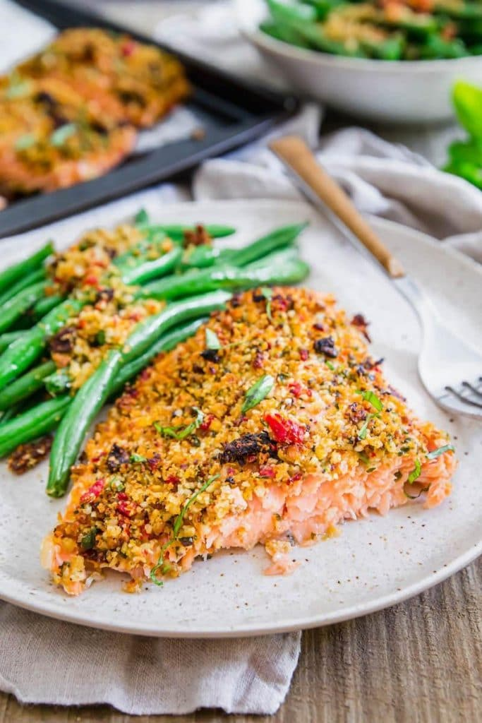 Sun-Dried Tomato Parmesan Crusted Salmon from The Novice Chef on foodiecrush.com