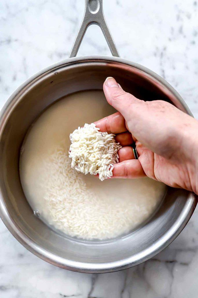 Rinse white rice in water foodiecrush.com