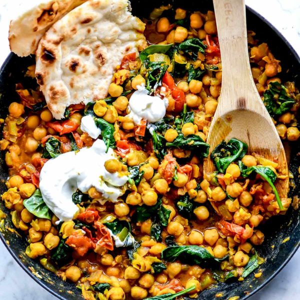 Chana Masala in skillet with yogurt foodiecrush.com