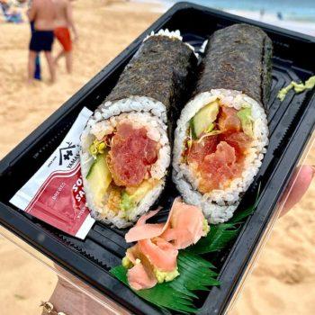 Spicy tuna handroll on beach foodiecrush.com