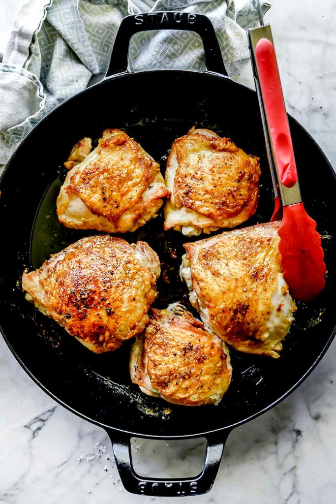 How to Cook THE BEST Chicken Thighs on stove then in oven foodiecrush.com