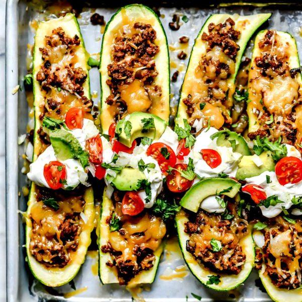 Taco Stuffed Zucchini Boats with toppings foodiecrush.com