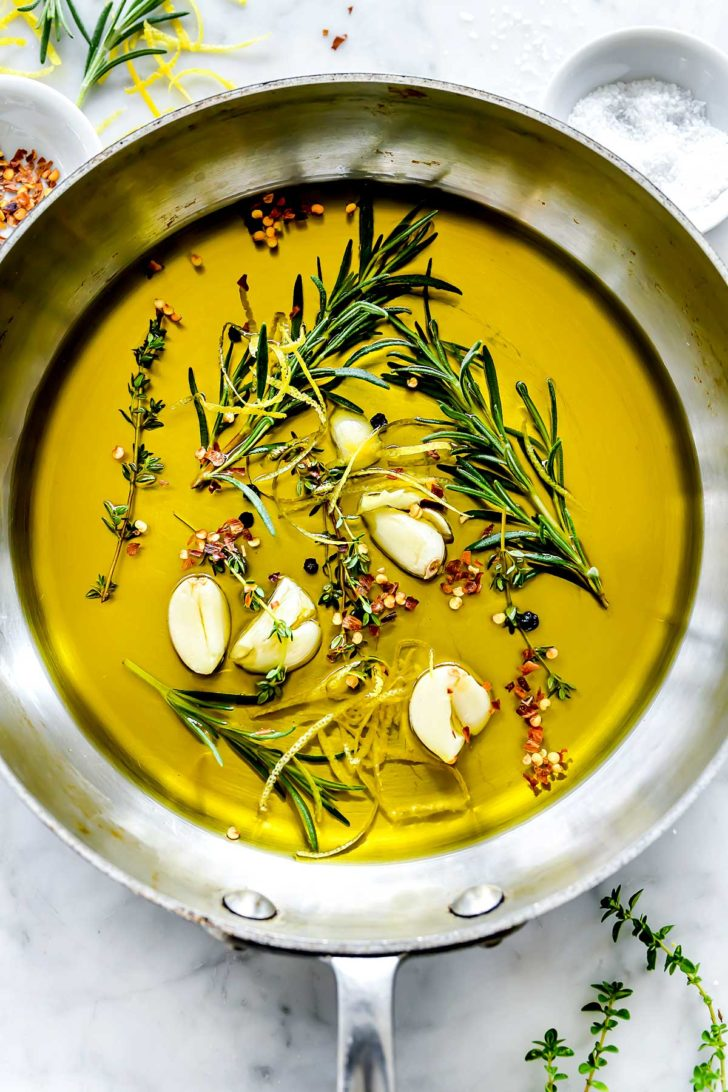 Steeped herbs and garlic in olive oil foodiecrush.com