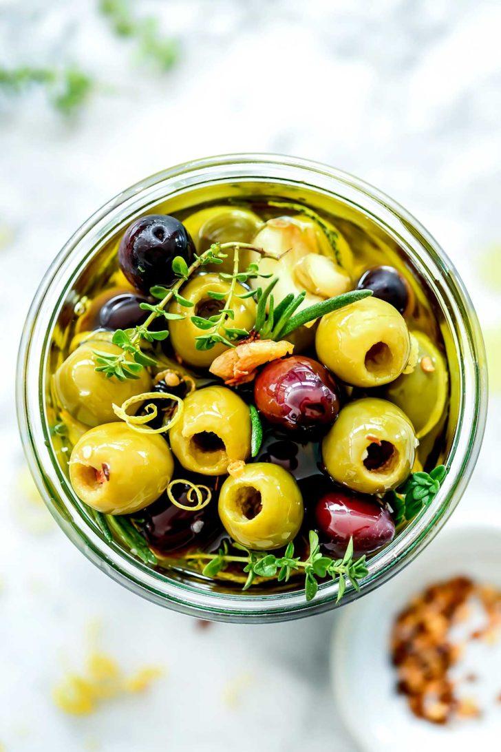 Marinated Olives in jar overhead foodiecrush.com